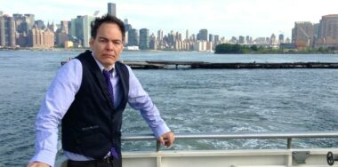 Hey Max Keiser, Who's the bigger con?